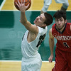 Dylan Buell | dylanphotog@gmail.com | @dylanphotog<br /> Dylan Jones #14 of the Western Hills Wolverines grabs a rebound during the game at Lapsley Cardwell Gym Monday night.