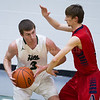 Dylan Buell | dylanphotog@gmail.com | @dylanphotog<br /> Patrick Foley #3 of the Western Hills Wolverines drives on Andrew Mitchell #1 of the Anderson County Bearcats during the game at Lapsley Cardwell Gym Monday night.