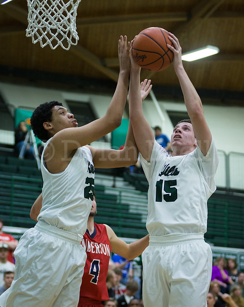 Dylan Buell | dylanphotog@gmail.com | @dylanphotog<br /> Troy Amanor #25 and Keaton Anderson #15 of the Western Hills Wolverines reach for a rebound during the game at Lapsley Cardwell Gym Monday night.