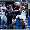 "Dylan Buell | dylanphotog@gmail.com | @dylanphotog<br /> Chase Cavanaugh #4 of the Kentucky Country Day Bearcats battles for a rebound during the All ""A"" Tournament at the Frankfort Convention Center Thursday."