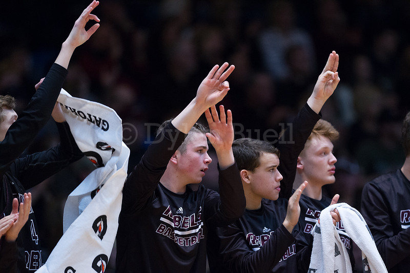 """Dylan Buell   dylanphotog@gmail.com   @dylanphotog<br /> The Owen County bench celebrates during the All """"A"""" Tournament at the Frankfort Convention Center Thursday."""