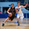 "Dylan Buell | dylanphotog@gmail.com | @dylanphotog<br /> Carson Williams #23 of the Owen County Rebels drives around Colin Ferguson #12 of the Kentucky Country Day Bearcats during the All ""A"" Tournament at the Frankfort Convention Center Thursday."
