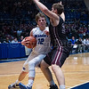 "Dylan Buell | dylanphotog@gmail.com | @dylanphotog<br /> Colin Ferguson #12 of the Kentucky Country Day Bearcats attempts to drive on Carson Williams #23 of the Owen County Rebels during the All ""A"" Tournament at the Frankfort Convention Center Thursday."