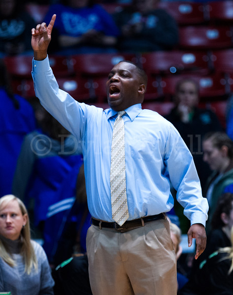 """Dylan Buell   dylanphotog@gmail.com   @dylanphotog<br /> Head coach Derrick Akal of the Harlan Dragons calls out instructions during the All """"A"""" Tournament at the Frankfort Convention Center Friday."""