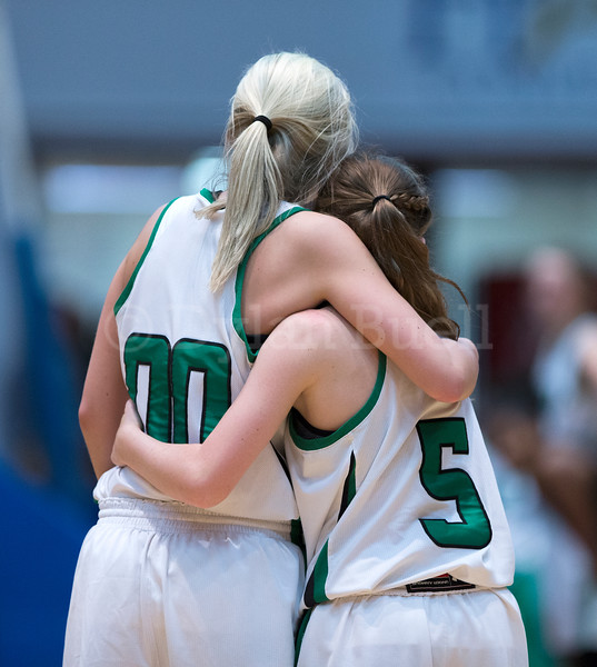 """Dylan Buell   dylanphotog@gmail.com   @dylanphotog<br /> Jordan Brock #00 and Payeton Charles #5 of the Harlan Dragons hug during the All """"A"""" Tournament at the Frankfort Convention Center Friday."""