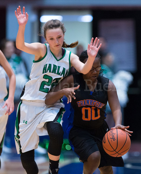 """Dylan Buell   dylanphotog@gmail.com   @dylanphotog<br /> Taylor Simpson #22 of the Harlan Dragons defends against T.T. Barnett #00 of the Frankfort Panthers during the All """"A"""" Tournament at the Frankfort Convention Center Friday."""