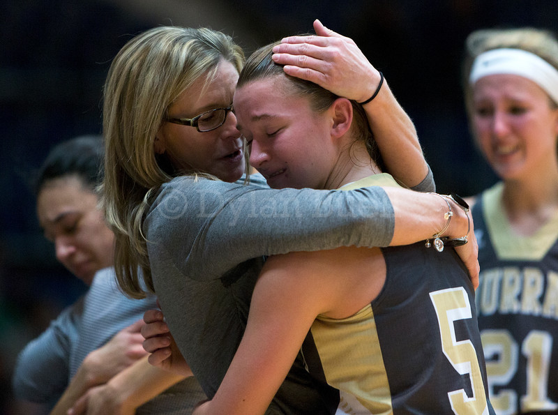"""Dylan Buell   dylanphotog@gmail.com   @dylanphotog<br /> Macey Turley #5 of the Murray Tigers gets a hug during the All """"A"""" Classic Championship at the Frankfort Convention Center Sunday."""