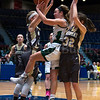 "Dylan Buell | dylanphotog@gmail.com | @dylanphotog<br /> Annabel Moore #22 of the Owensboro Catholic Aces attempts a shot between Maddie Waldrop #21 and Alexis Burpo #32 of the Murray Tigers during the All ""A"" Classic Championship at the Frankfort Convention Center Sunday."
