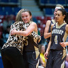 "Dylan Buell | dylanphotog@gmail.com | @dylanphotog<br /> Macey Turley #5 of the Murray Tigers hugs head coach Rechelle Turner during the All ""A"" Classic Championship at the Frankfort Convention Center Sunday."