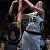"Dylan Buell | dylanphotog@gmail.com | @dylanphotog<br /> Alexandria Mayes #4 of the Murray Tigers attempts to block a shot attempt by Caroline Hayden #25 of the Owensboro Catholic Aces during the All ""A"" Classic Championship at the Frankfort Convention Center Sunday."