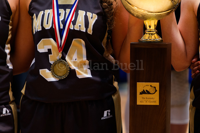 "Dylan Buell | dylanphotog@gmail.com | @dylanphotog<br /> The Murray girls basketball team poses for a photo after winning the All ""A"" Classic Championship at the Frankfort Convention Center Sunday."