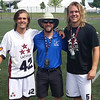 Riley (42) and Eli (5) Lasda, representing Latvia, with UAlbany assistant Coach Eric Wolf, representing Israel, at the World Lacrosse Championships.