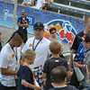 Lyle Thompson (left, in the white shirt) and Miles Thompson (center) sign autographs for fans at the World Lacrosse Championships. Photo Kenny Frost, Iroquois Nationals