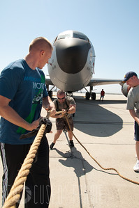 Air Force Master Sgt. Josh Bell pulls a KC-135 Stratotanker at March Air Reserve Base, CA on May 16, 2012 in preparation for the upcoming Air Show.