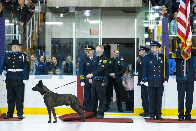 Sergeant Chad Draper, Hutch's handler and Hutch drop the puck prior to the start of the game
