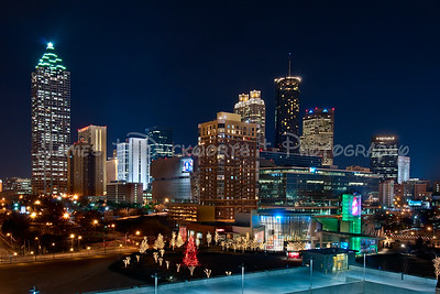 View of downtown Atlanta looking southeast from a parking deck near the Georgia Aquarium.  The World of Coke is in the foreground decorated for the Holidays.