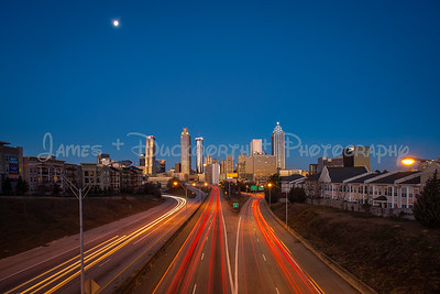 A wide view at twilight of Atlanta's skyline from the Jackson Street Bridge.