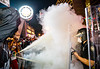 Riots have broken out in Atlanta around the CNN Center and on Friday, May 29, 2020.  Protesters spray fire extinquishers at police as they clash at the corner of Marietta Street and Centennial Olympic Park.  (Jenni Girtman for The Atlanta Journal-Constitution)
