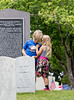 The Marietta National Cemetery did not hold official ceremonies this year, however, small groups gathered to watch the four Blackhawk helicopter flyover on Memorial Day, Monday, May 25, 2020.  Rylan Durocher, 7, left, and his sister 4-year-old Ella Durocher of Marietta attend their first Memorial Day event. (Jenni Girtman for The Atlanta Journal Constitution)