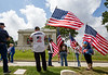 The Marietta National Cemetery did not hold official ceremonies this year, however, small groups gathered to watch the four Blackhawk helicopter flyover on Memorial Day, Monday, May 25, 2020.  (Jenni Girtman for The Atlanta Journal Constitution)
