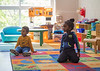 After nap time at East Lake YMCA Early Learning Academy Aubrey Yates, 4, left, and 3-year-old Ciete Roach, right, wait for the groups next activity Friday, April 10, 2020.  Kids are spaced out into multiple class rooms where four kids are in a room usually busy with 16 children.  (Jenni Girtman for Atlanta Journal Constitution)