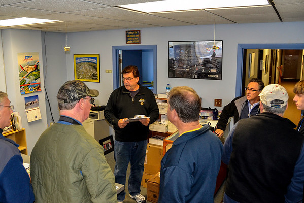 Retired Boston Tracon controller Robert Adelizzi and FCA owner Charley Valera brief pilots on the flight