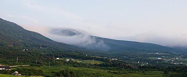 Mist rolling off the mountains onto Bay St. Lawrence