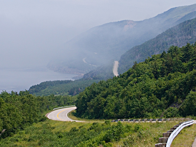 Looking north from the same turnout, the Cabot Trail continues along the coast and into the mist.