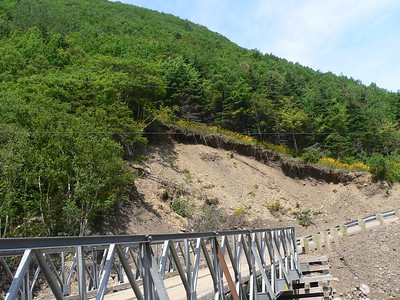 In August 2010 Meat Cove experienced flash flooding that took out 3 bridges on Meat Cove Road, the road and bridge to the  beach, and substantial portions of the boardwalk to the beach. Here you can see the new road and temporary bridge contruction, and erosion from the flood. For more information on the flood, with before and after pictures, see http://meatcoveflood.com/index.htm