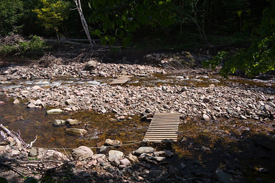 Portions of the boardwalk have been repaired, but the section from the Cafe deck has not. See this link for the boardwalk route before the flood: http://poptopcamper.freehostia.com/river_board_walk_trail.htm