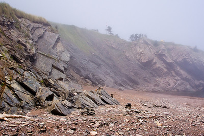Further down the beach. That's Meat Cove Campground above the cliff - you can see a yellow tent right at the edge.