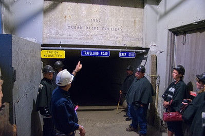 The entrance to the Ocean Deep Colliery. Note the hard hats and rain capes worn by the visitors.