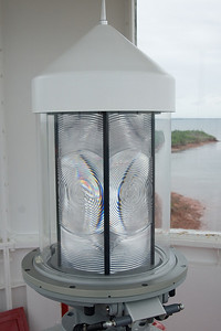 The modern electric light and rotating housing. The housing is apparently always rotating even when the light is not on.