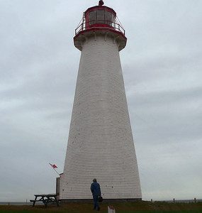 "It is the oldest lighthouse on PEI (1846) and the only round one. Its walls are 18"" thick made of brick. Years after original construction it was sheathed with wooden strapping and shingles. Height in meters above ground: 18.3.  It was not the best day for shooting from the top of a lighthouse - overcast and occasional drizzle."