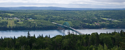 A turnout on the Trans Canada Highway, looking WSW. The bridge is the continuation of the Trans Canada, linking the western portion of Cape Breton to Boularderie Island. The lighthouse is most likely the McNeil Beach lighthouse.