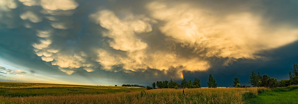 Mammatus Clouds and Rainbow