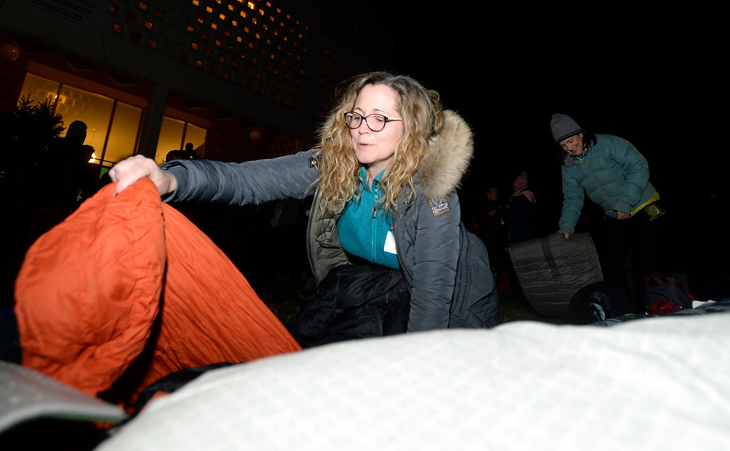. BOULDER, CO - NOVEMBER 8, 2018: Boulder High School teachers Caryln Carroll, left, and Kate Villarreal set out their sleeping bags during the Sleep Out hosted by Attention Homes to bring awareness to the homeless youth problem on Thursday night at the First United Methodist Church in Boulder. For more photos of the event go to dailycamera.com Jeremy Papasso/ Staff Photographer