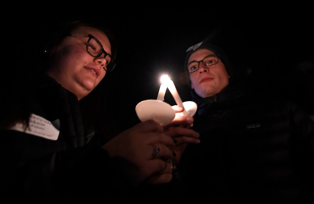 . BOULDER, CO - NOVEMBER 8, 2018: Beca Ericsson, left, and Blake Edmond light candles for a moment of silence during the Sleep Out hosted by Attention Homes to bring awareness to the homeless youth problem on Thursday night at the First United Methodist Church in Boulder. For more photos of the event go to dailycamera.com Jeremy Papasso/ Staff Photographer