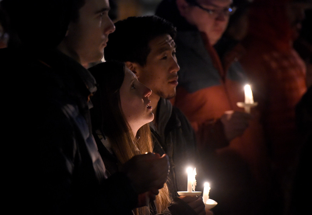. BOULDER, CO - NOVEMBER 8, 2018: University of Colorado senior Bryan Roberts, left, junior Rebecca Lockyear and junior Aaron Lu hold candles during a moment of silence during the Sleep Out hosted by Attention Homes to bring awareness to the homeless youth problem on Thursday night at the First United Methodist Church in Boulder. For more photos of the event go to dailycamera.com Jeremy Papasso/ Staff Photographer