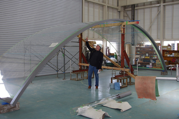 Inspecting the largest acrylic panel for the zoo - over 40 feet long and nine feet high