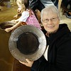 A visitor to Gold Dredge 8 shows off her find after panning for gold.