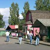 Visitors tour the rustic shops and galleries of Alaskaland Pioneer Park in Fairbanks, Alaska.