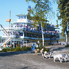 Credit: Riverboat Discovery<br /> <br /> Passengers aboard the Riverboat Discovery watch a dog sled demonstration at Chena Indian Village in Fairbanks, Alaska.
