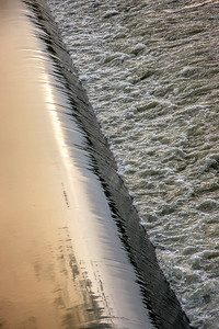 Water flowing over Wier