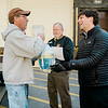 Local Teamsters 170 hand out turkeys to Aubuchon employees at the facility in Westminster on Tuesday evening. Jonathan Dudley hands a turkey off to Daniel Gallivan Jr. SENTINEL & ENTERPRISE / Ashley Green