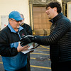 Local Teamsters 170 hand out turkeys to Aubuchon employees at the facility in Westminster on Tuesday evening. Jonathan Dudley hands a turkey off to Tim Gordon. SENTINEL & ENTERPRISE / Ashley Green