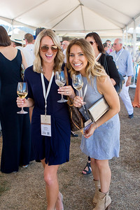 Guests living it up at the Barrel Auction.  Briana Marie Photography for Napa Valley Vintners