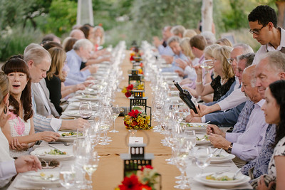 High bidders and vintners enjoying dinner service at Quintessa Winery event.  Briana Marie Photography for Napa Valley Vintners