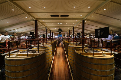 The upper deck of the Robert Mondavi Winery barrel room during the auction.   Photo by Bob McClenahan for the Napa Valley Vintners