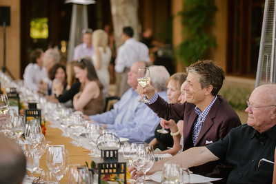 Agustin Huneeus toasts his guests at the dinner for top bidders and vintners at Quintessa Winery.   Briana Marie Photography for Napa Valley Vintners